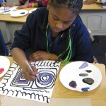 """REFLECT: """"Art is important to me because it makes me feel calm. In this picture I was having a rough day until art class. I was mixing paint and focused on my painting."""""""
