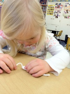 fine motor engagement: making tiny snakes with clay
