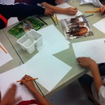 Students sketching plans for their Animal Power masks.