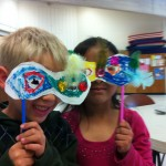 Students show off their Carnivale masks.