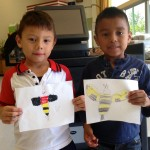 Students showing off their bumble bee costume designs