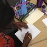 Observational drawing: student drawing a button from life.