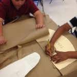 Students traced their paper collars from templates.
