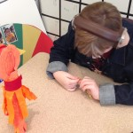 Twisting pipe cleaners to adorn a Sun Column.