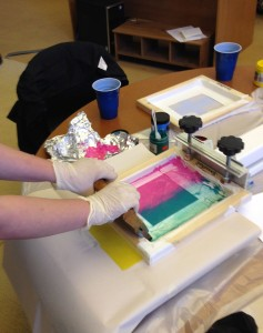 Student pulling a screen print.