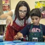 Mentor Artist Suzanne Joyal helps out