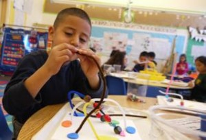 Students practice perseverance and fine motor control as they find beads for their sculpture