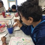 Students practiced line-making with tempera cake paints.