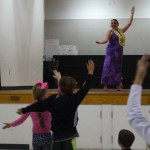 Students emulate the dancers