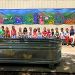 2nd grade Green Team and teachers group photo with completed mural