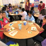 students practice creating and painting flowers
