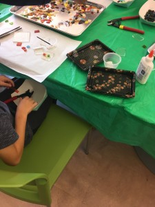 Students are taught how to safely cut glass for their pendants