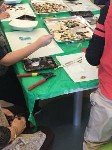 Students at Compass Academy fuse glass to make pendant necklaces!